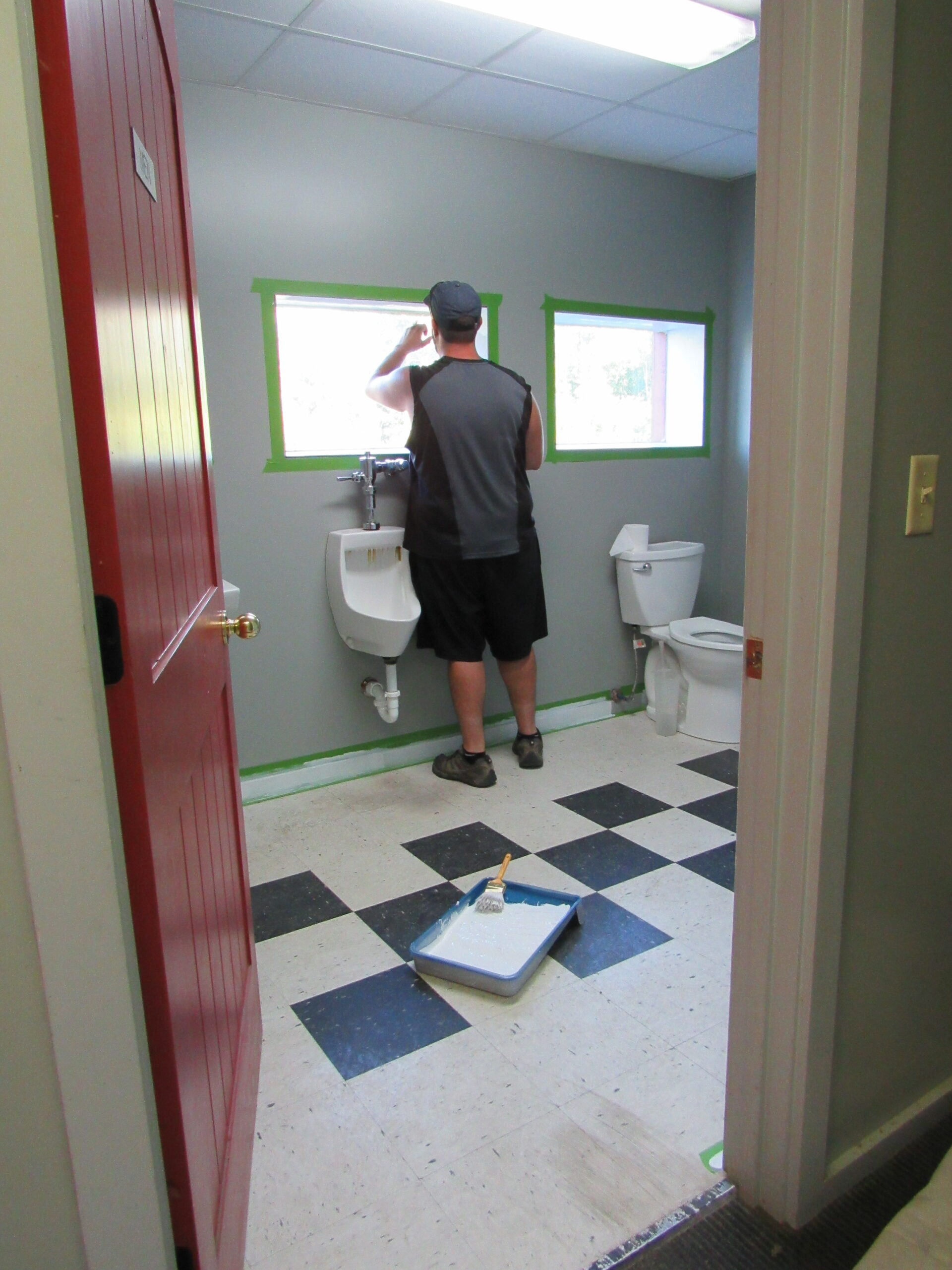 Phil painting the bathroom