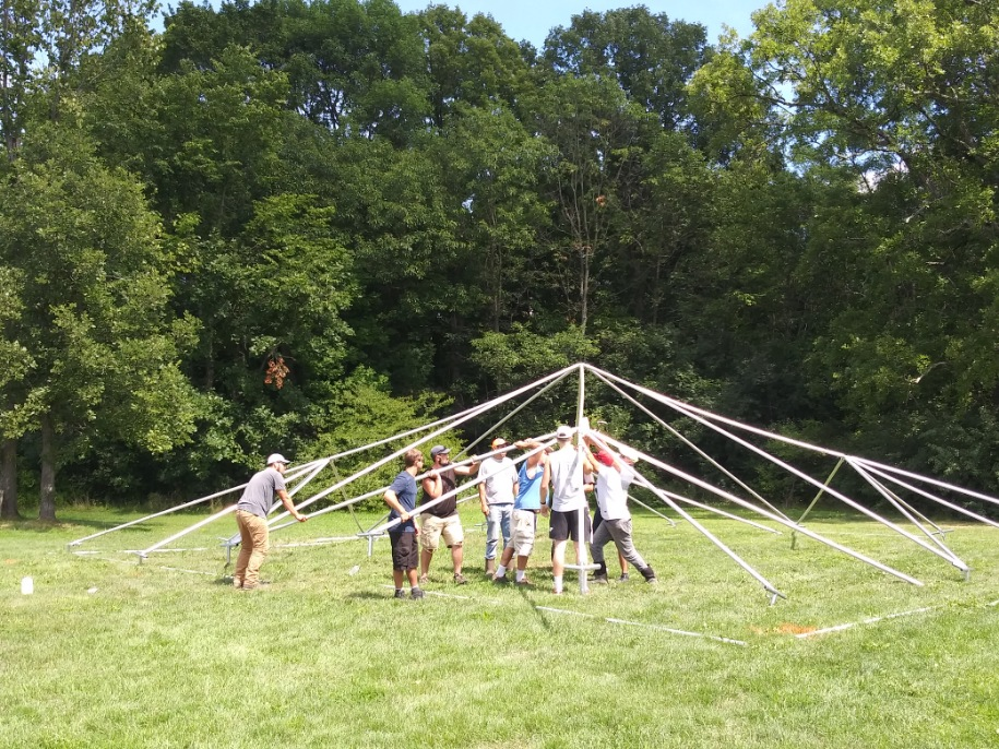 Crew setting up the tent at Hartford Greens Country Club