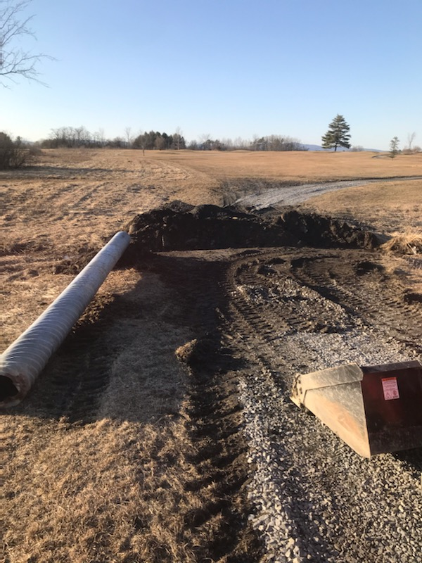 Laying pipe in cart path