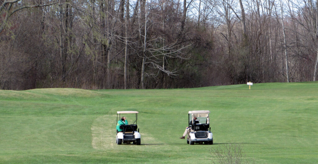 High school golf team coaches talking in carts at Hartford Greens Country Club